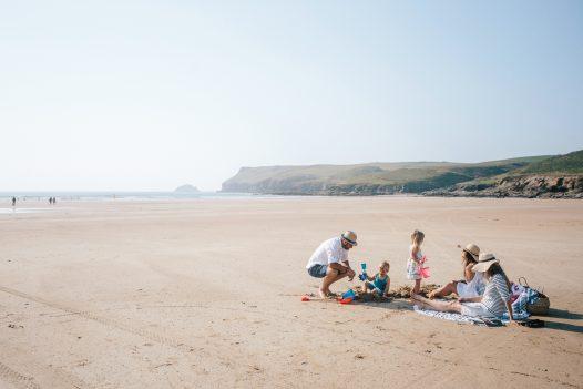 Family enjoying a beach day on Polzeath beach