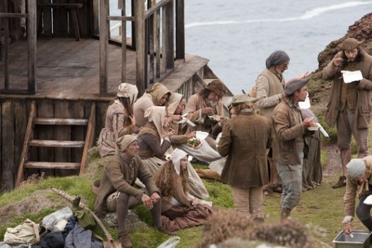 Extras having lunch together on the set of Poldark