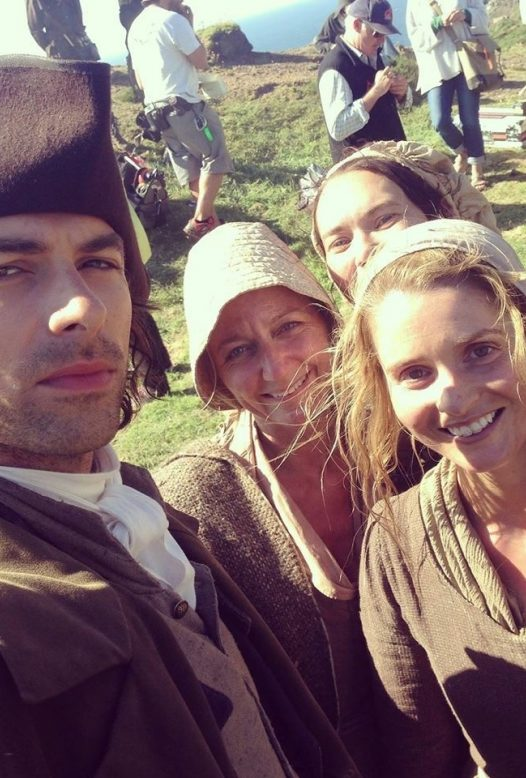 Aidan Turner taking a selfie with the Poldark extras