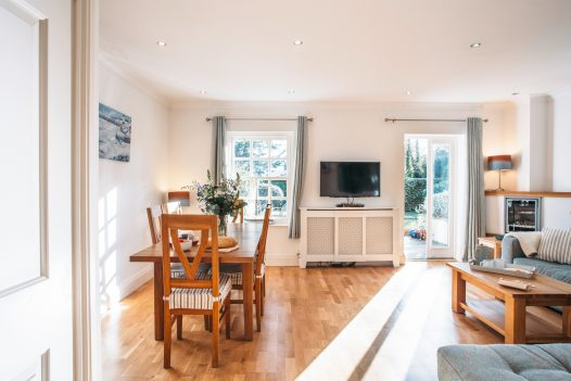 The open plan lounge and dining area at 1 Lowenna Manor, a self-catering holiday cottage in Rock, North Cornwall