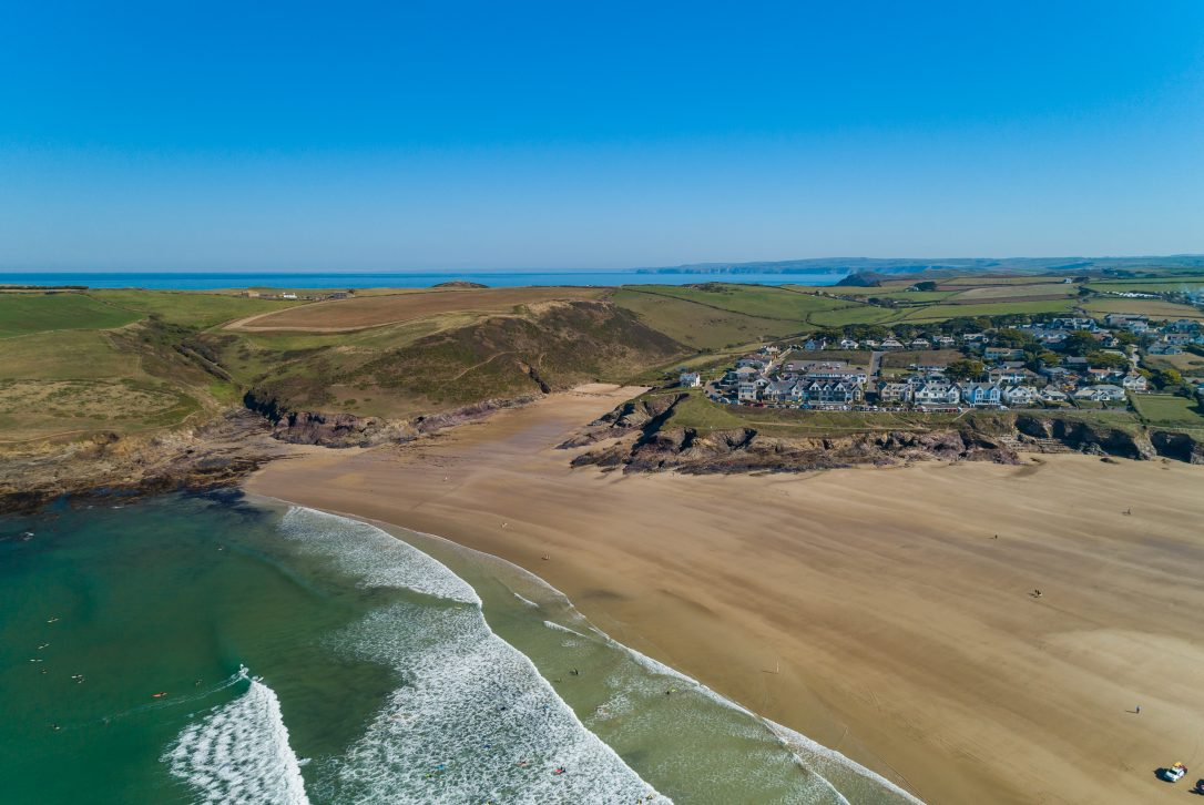 An aerial view of Polzeath Beach and Baby Bay, North Cornwall