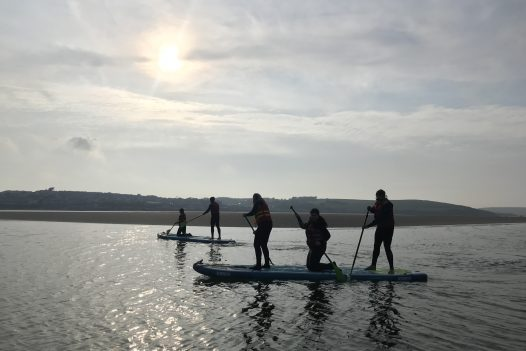 Stand up paddle boarding in the Camel Esuary with Camel Ski School. Rock, North Cornwall