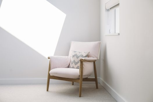 Scandi chair at Carn Mar, a self-catering holiday home above Polzeath beach, North Cornwall