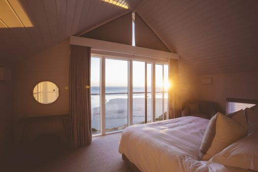 Sunset view from the master bedroom at Carn Mar, a self-catering holiday home in Polzeath, North Cornwall