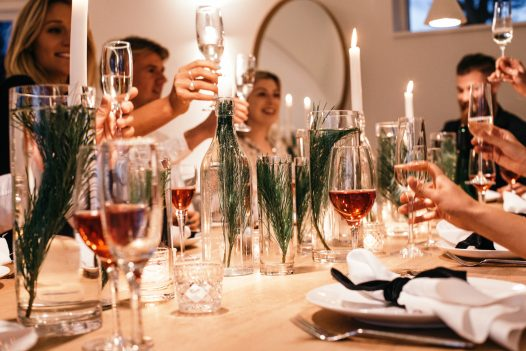 A festive meal around the dining table at Carn Mar, a self-catering holiday home in Polzeath, North Cornwall