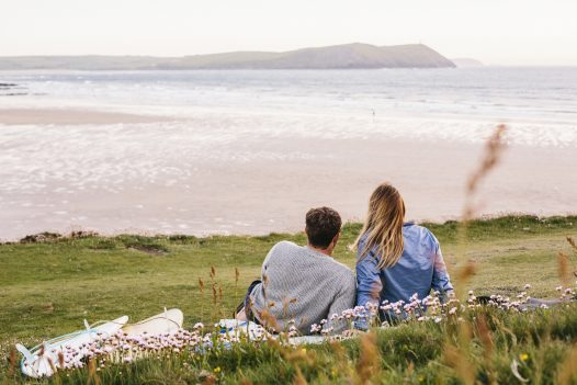 Enjoy views of the surf from Carn Mar, a luxury self-catering holiday home above Polzeath beach, North Cornwall