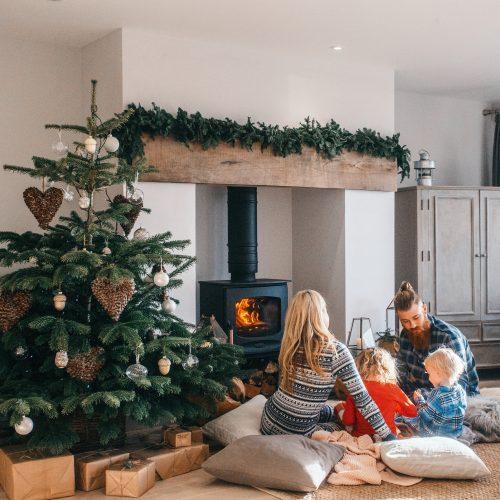 Family around the log burner at Christmas