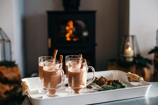 Cups of hot chocolate by the fire at Compit, a self-catering holiday home in Polzeath, North Cornwall