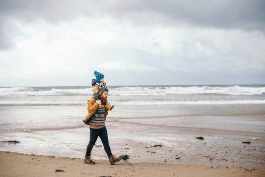 Father and son on Polzeath beach
