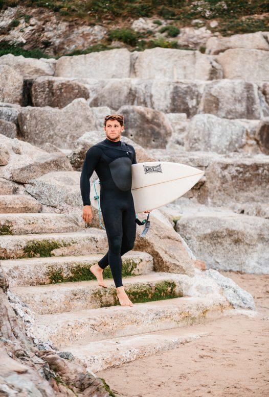 Surfer at Polzeath beach, North Cornwall