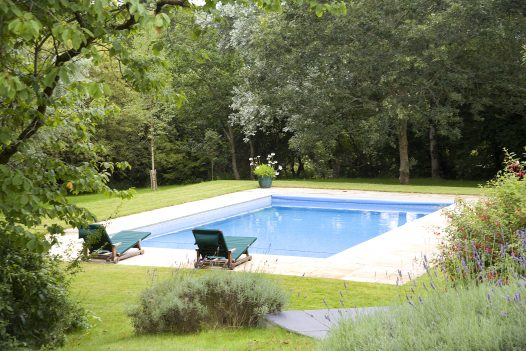The heated outdoor swimming pool Buzza Vean, a self-catering holiday home in Rock, North Cornwall