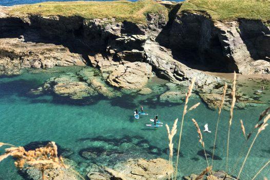 View of kayakers at Port Gaverne, North Cornwall
