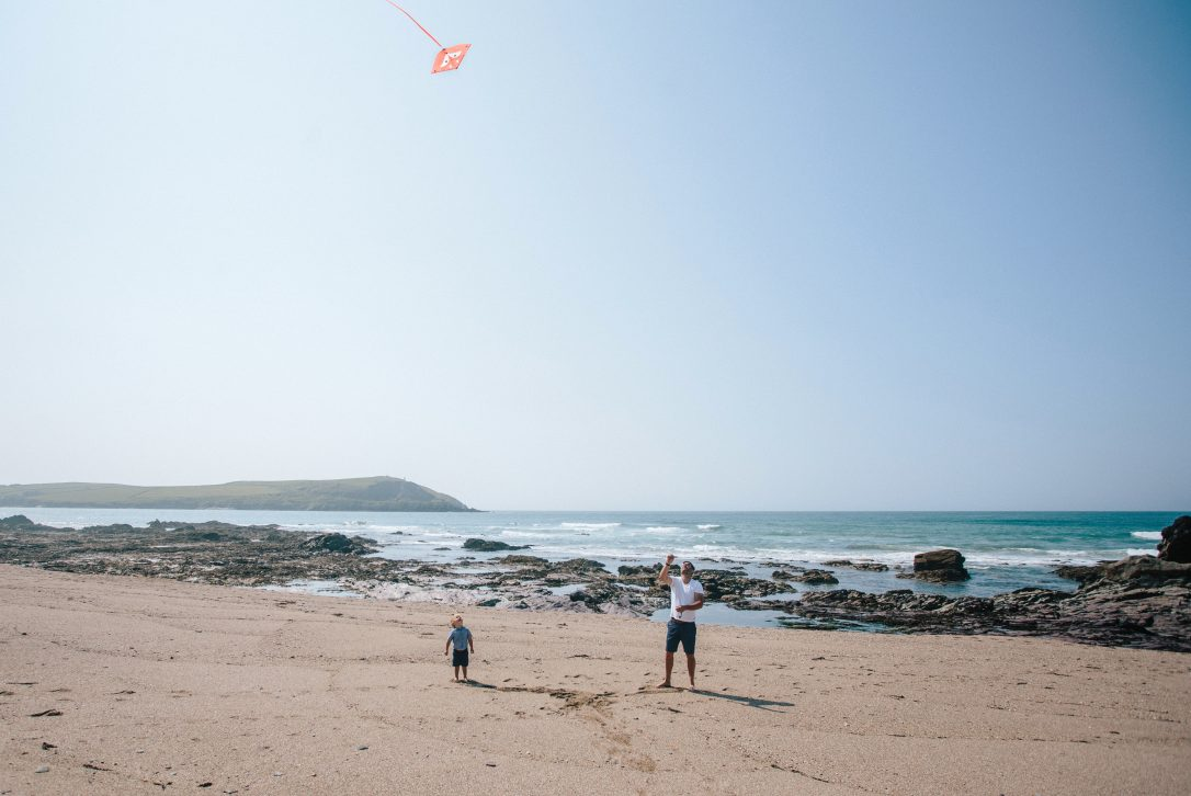 Family playing on Greenaway beach, near Polzeath, North Cornwall