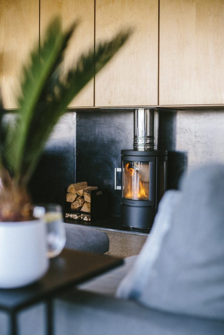 Log burner at Dry Creek House, a self-catering eco home in Polzeath, North Cornwall
