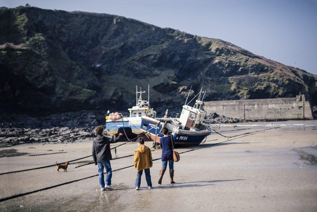 Family on Port Isaac beach, North Cornwall