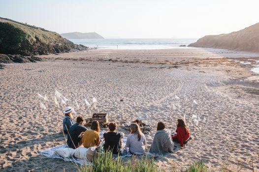 Group having a beach barbecue on Baby Bay, Polzeath, North Cornwall