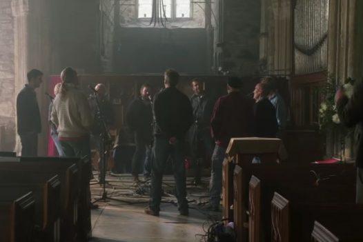 A scene from the Fisherman's Friends movie, filmed in Saint James Church in St Kew