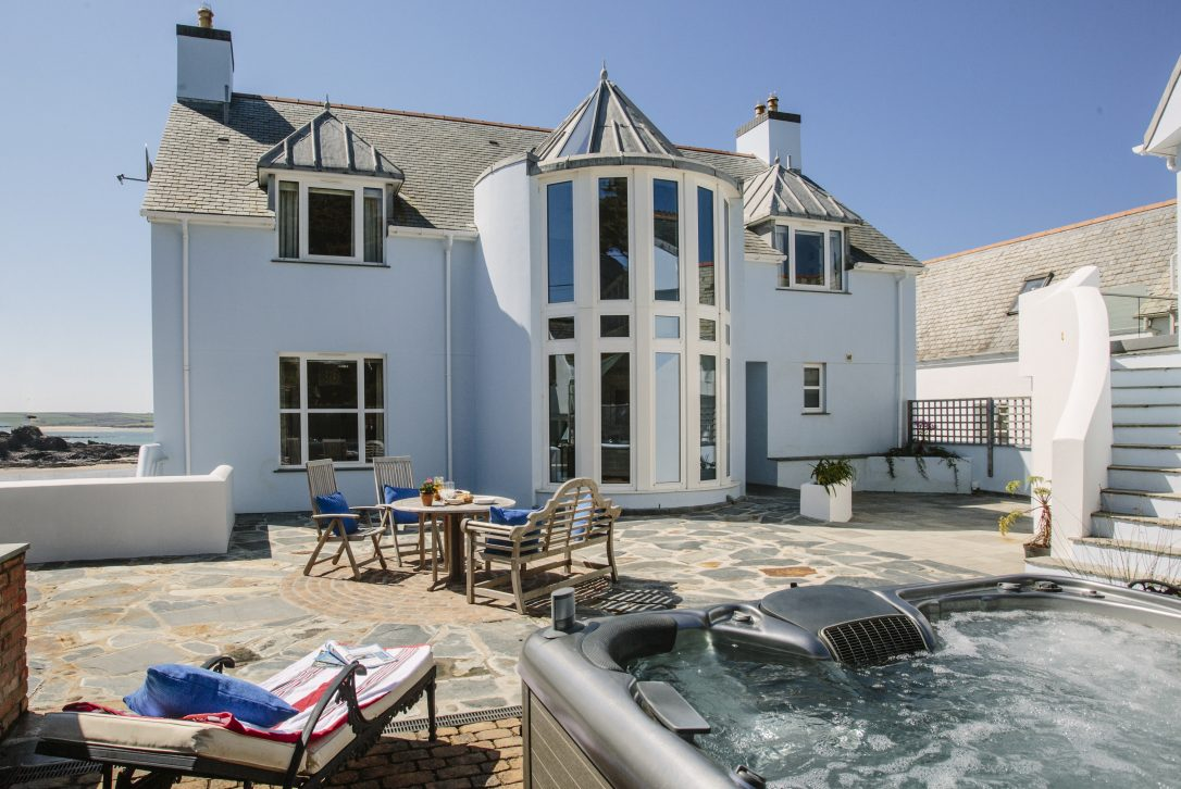 Large hot tub at Tristram, a self-catering holiday home sleeping 14 above Polzeath beach, North Cornwall