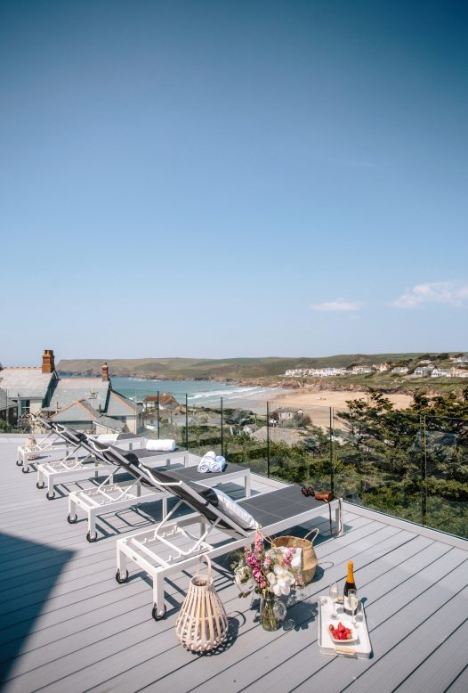 The hot tub at Parker's Place is on the spacious sun deck with views of Polzeath beach