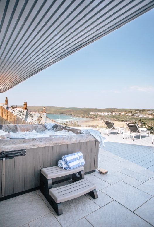 Enjoy sea views from the hot tub at Parker's Place, a self-catering holiday home in Polzeath, North Cornwall