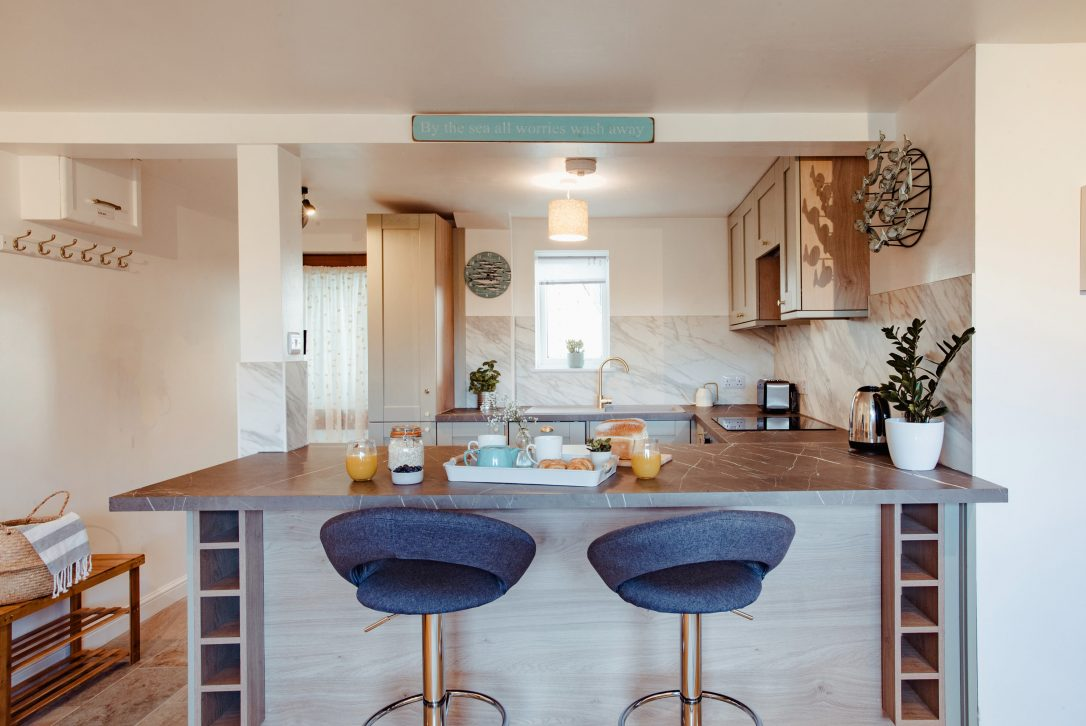 Enjoy quality time together in the open plan living area at Penhwedhi in New Polzeath