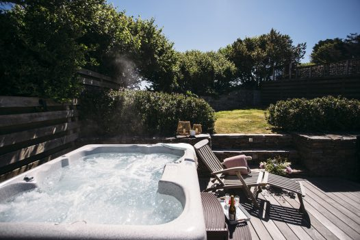 Hot tub in the garden at The Retreat, a self-catering holiday home in Polzeath, North Cornwall