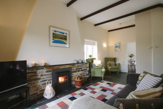 Cosy up beside the log burner at The Linhaye near Port Isaac - the perfect self-catering escape for Valentine's Day