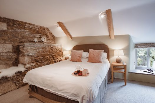 The romantic master bedroom at Penquite Cottage near Port Isaac