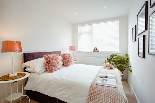 Pretty in pink - the romantic double bedroom at The Port House in Port Isaac