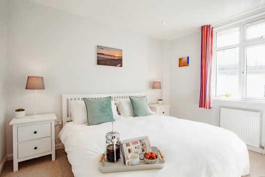Bedroom at Hillcote a self-catering holiday home in Polzeath, North Cornwall, available on a low occupancy rate.