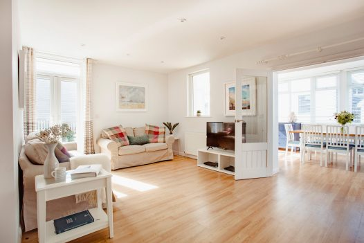Light and bright lounge at Hillcote a self-catering holiday home in Polzeath, North Cornwall, available on a low occupancy rate.