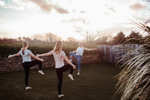 Yoga in the garden at Fiddlesticks a self-catering holiday home in Rock, North Cornwall, available on a low occupancy rate.