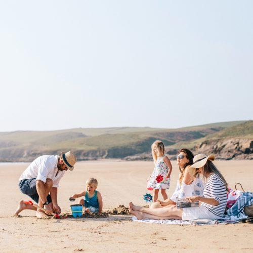 Family enjoying Polzeath beach during May half term
