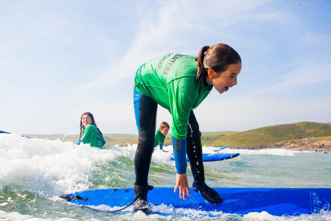 Surfing, Polzeath beach, North Cornwall