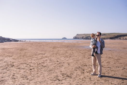 Father and son on Polzeath Beach, North Cornwall