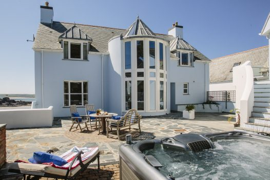 Hot tub and patio at Tristram, a self-catering holiday home in New Polzeath, North Cornwall