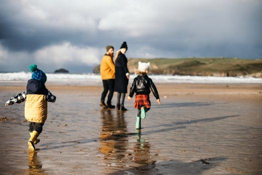 Family playing on Polzeath beach, North Cornwall