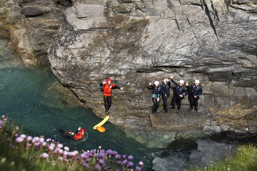 Take to the water with Cornish Rock Tors and enjoy a coasteering session at Port Gaverne when you stay at Penquite