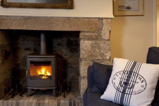 Log burner at Penquite, a luxury self-catering home near Port Isaac