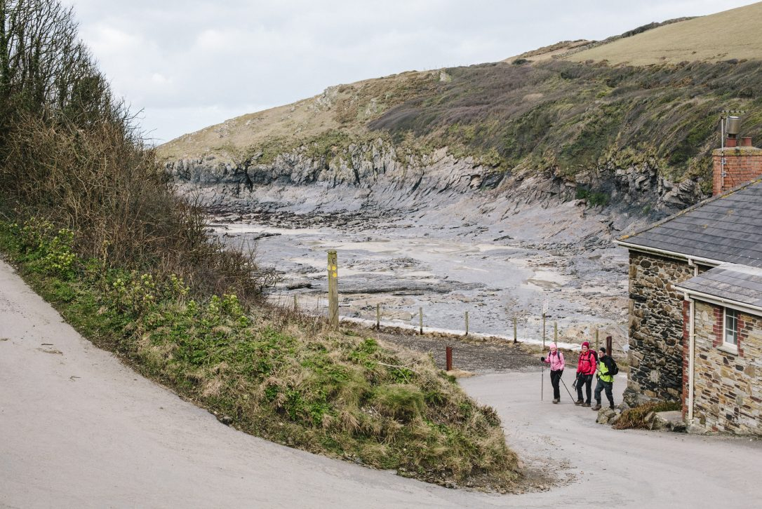 Walkers in Port Quin, North Cornwall