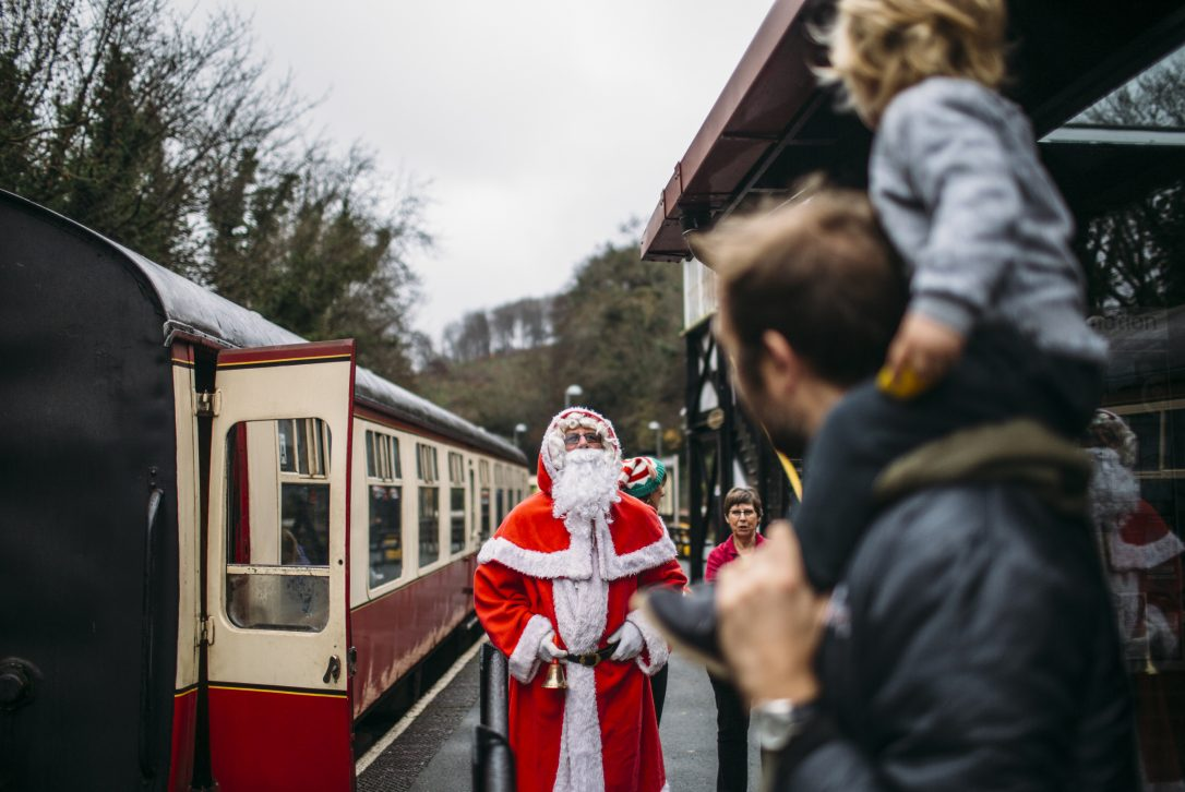 Santa welcomes children aboard the Santa by Steam train at Bodmin General Station, North Cornwall.