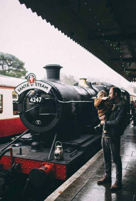Children boarding the Santa by Steam train at Bodmin General Station, North Cornwall.