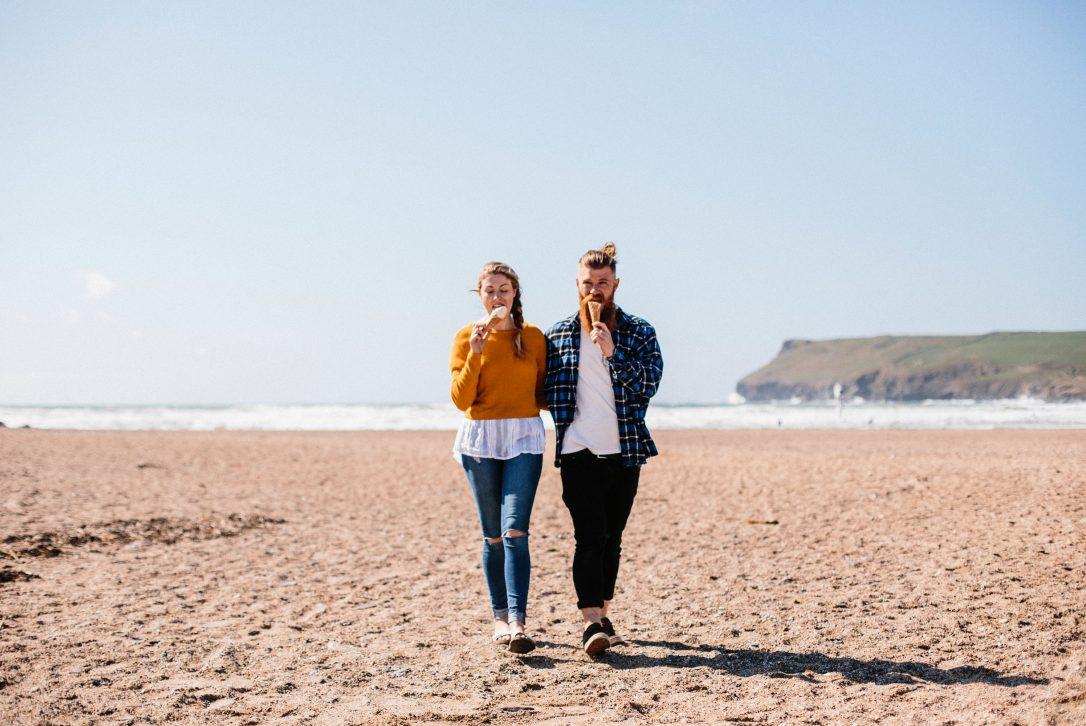 Couple on Polzeath Beach, North Cornwall.