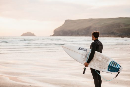Surfer on Polzeath beach, North Cornwall
