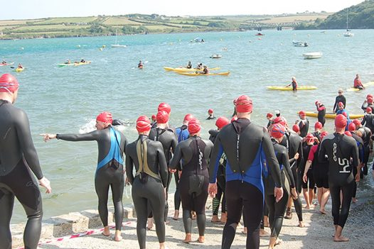 Swimmers ready for the Padstow to Rock swim in aid of Marie Curie