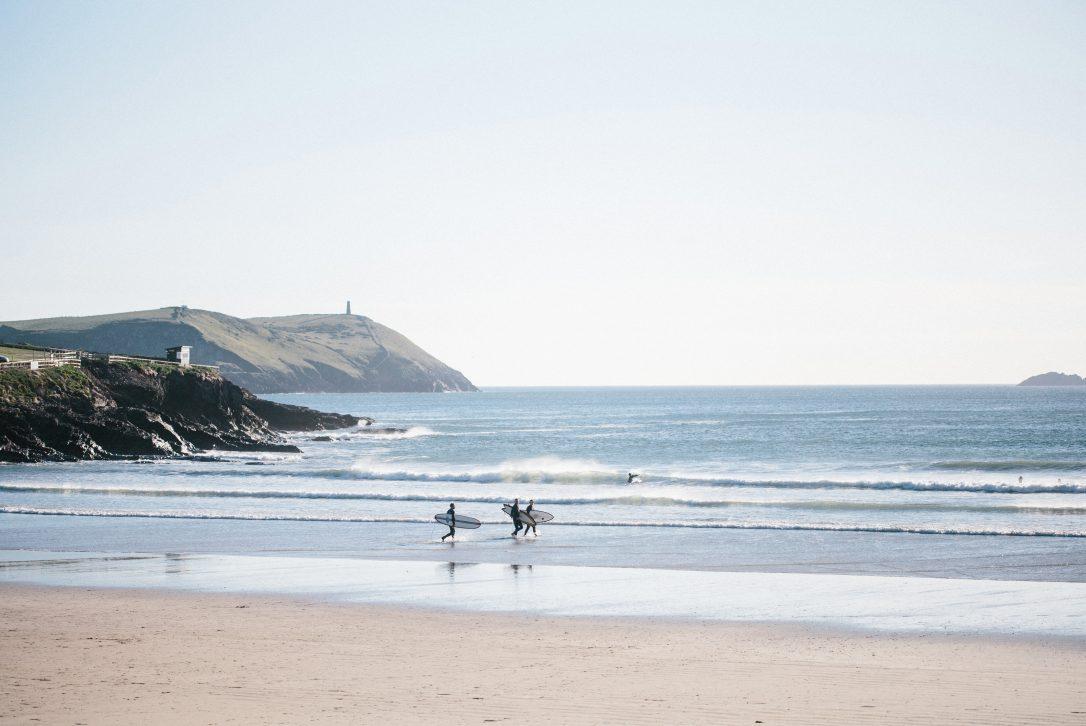 Surfers on Polzeath beach, north Cornwall
