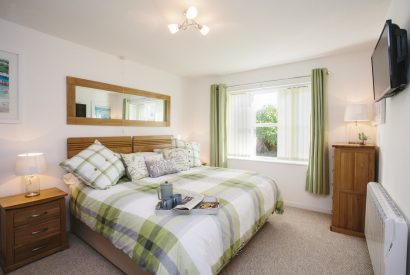 Bedroom one at 1 Menague, a self-catering holiday cottage in Rock, North Cornwall