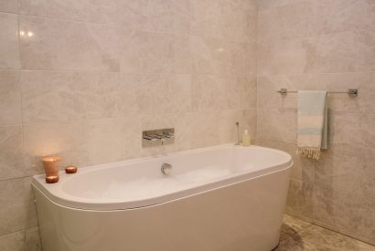 Bath tub Bedroom two is beautifully decorated with a calming coastal colour pallette
