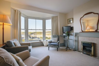 Living room at No 2 Pentire View, a self-catering holiday home in Polzeath, North Cornwall