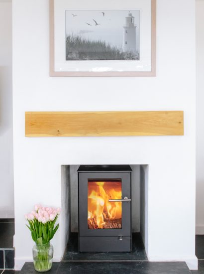 Log burner at Badger Cottage, a self-catering holiday home in Rock, North Cornwall